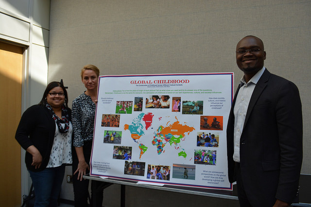 Students from Social Construction of Childhood present a poster on global perspectives of childhood