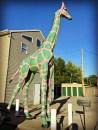 pink giraffe with green spot