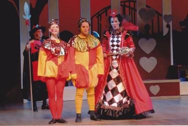 Tweedle Dee (Joy Rogers) and Tweedle Dum (James Walker) take orders from the evil Queen of Hearts (Caitlin Clugston).