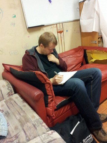 Producer Jerret Schwartz crunches some numbers at rehearsal. Hearing us sing helps him crunch better.