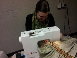 Costume Coordinator Christy Zaporozan fixes a dress at the theatre.
