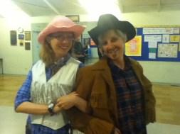 Joni Hayden-Summerton and Barbie Warwick get a long little doggie at the Halloween rehearsal.