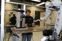 Welding student Cole Warzynski tests an automated application on a robotic welder in our new Appleton lab.