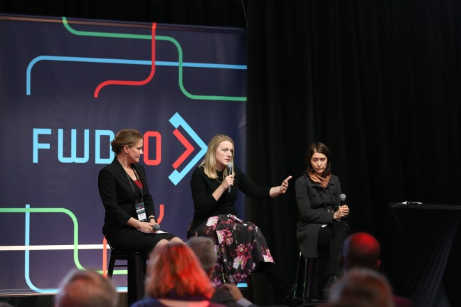 Panelists on a breakout stage