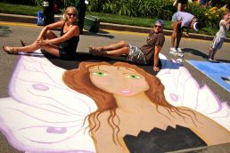 Cary (L) with her chalk walk design.