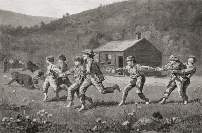 """Snap the Whip"" shows 9 children playing the game snap the whip. The children in the front have fallen, while the children in the back are holding onto each other. In the background is a schoolhouse nestled among the hills. Barefoot and playing in the grass, children are dressed in pants, hats, and suspenders."
