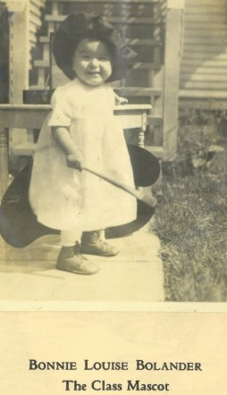 A black and white photo of Bonnie Louise Bolander as a baby, paintbrush in hand.