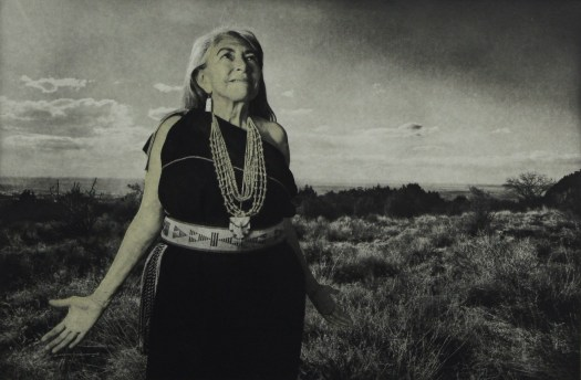 Wilbur's photo shows Dr. Mary, a Native American woman in Native dress standing in her Native land.