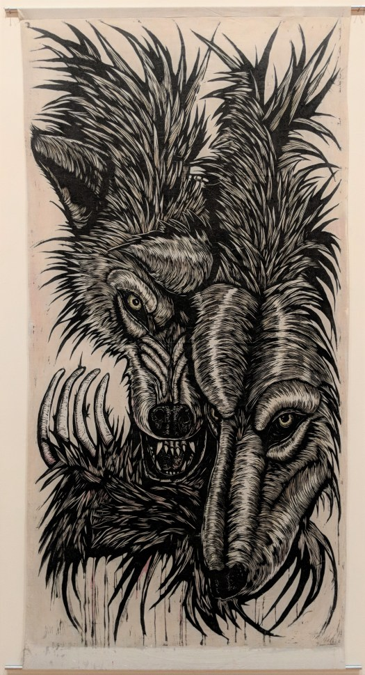 A screenprint of two wolves faces melding into one, with the claws of one open and extended in front of their faces.