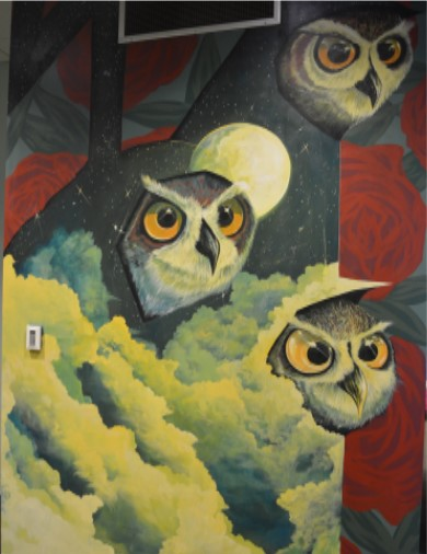 One half of Nosego's mural at FWMoA shows three owl faces in the sky, emerging from big, puffy clouds, against a background of red roses.