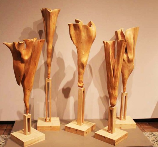 Five wooden sculptures, unconnected, create this one work.