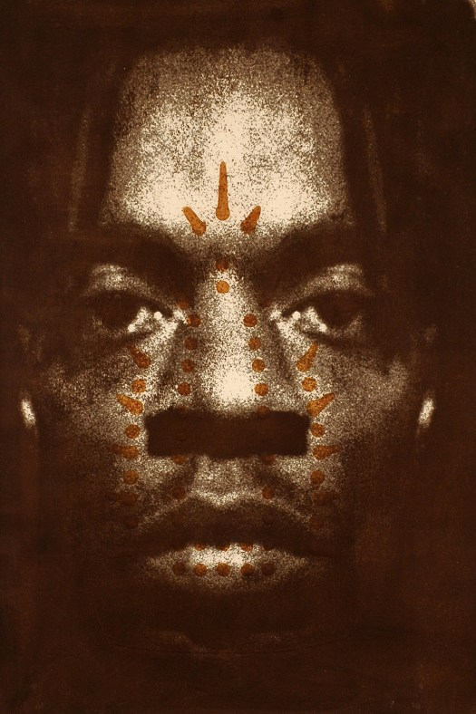 Image of a Black man's face inverted and superimposed over a scorched iron pattern.