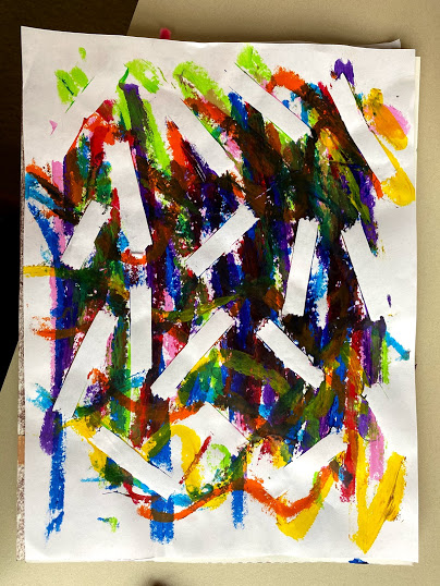 This child chose to create an abstract work full of color. Overtop the colored paint stick lines, white pieces of tape are stuck in a random pattern to break up the mass of color.