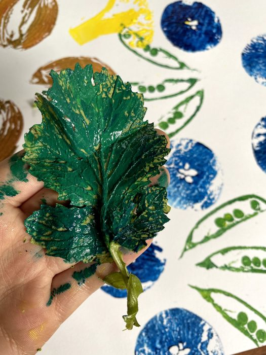 This shows how to thinly layer the paint on a radish leaf, in order to show the veins when you stamp.