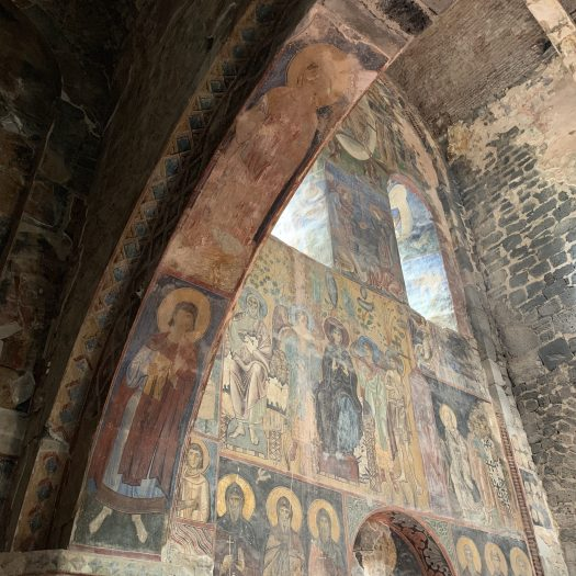 Wall frescoes inside a monastery. Though faded, various biblical figures can still be seen.