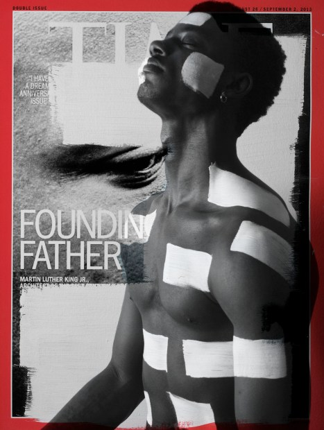 "A Black man, eyes closed, raises his head. He is painted with block, white stripes on his face, chest, and neck. he is superimposed on a TIME magazine cover with the words ""Founding Father"" and ""Martin Luther King Jr"". The rest of the list is whited out."