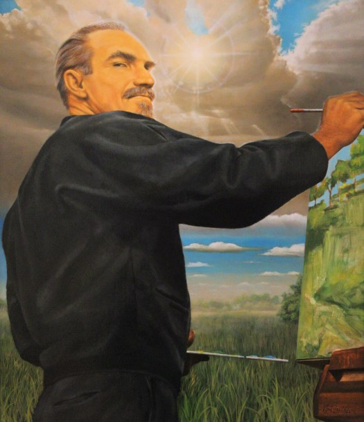 Artist George McCullough paints a landscape on his canvas. His back is turned to the audience, and he looks at the viewer over his shoulder. In the background, a landscape and clouds, as if he is painting outside.