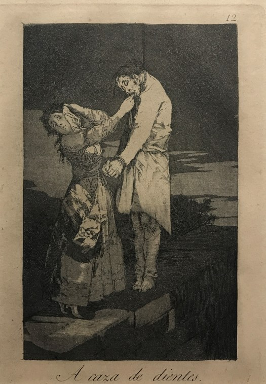 A woman, who averts her gaze and protects her face, pulls the teeth of a hanged man for their purported use in spells.