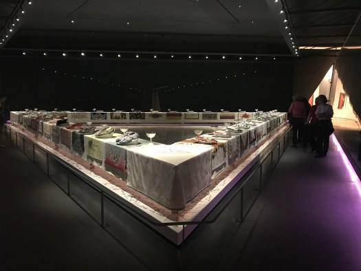 A gallery shot of Judy Chicago's Dinner Party at the Brooklyn Museum of Art.