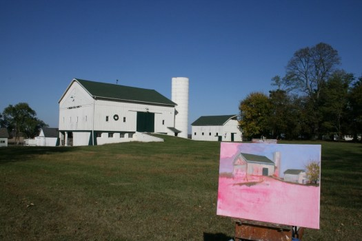 The beginning of a painting of a white barn shows the rose tint that underlies the completed composition.