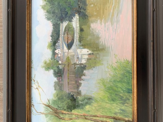 The en plein air painting shows a bridge in the distance, the river taking up most of the composition. In the left-hand corner is grass and trees. Behind the bridge, in the far distance, is a town.