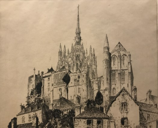 An etching of French cathedral Mont-Saint-Michel shows the church from below, towering into the sky with houses nestled at its base. Black, whites, and greys create shadows, tones, and values.