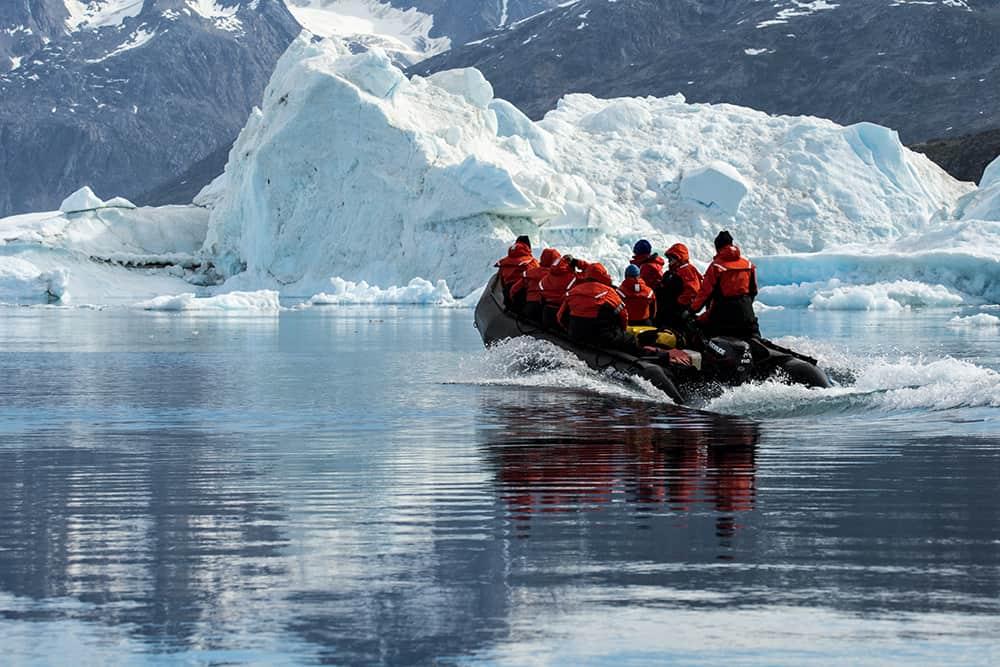 A Zodiac near an iceberg