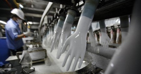 Employee crunch hits world's prime medical glove maker as demand spikes