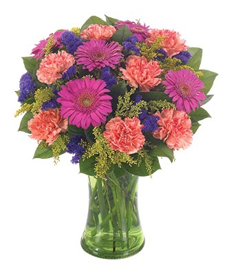 Feel in  Good at From You Flowers Hot pink gerbera daisies  orange carnations and purple flowers in vase
