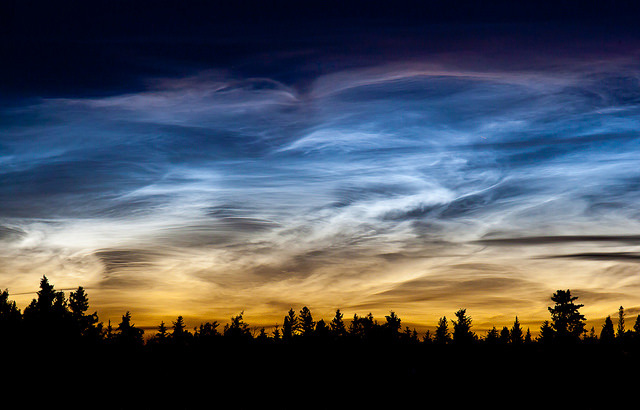 Noctilucent clouds at sunset