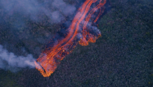 Still image of smoke rising from a lava flow