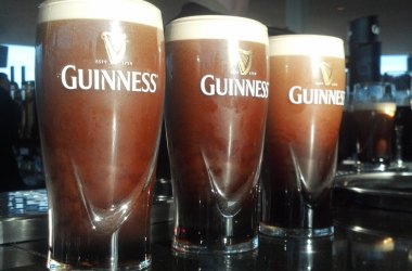Three Guinness beers, well known for their nitro bubble cascades.