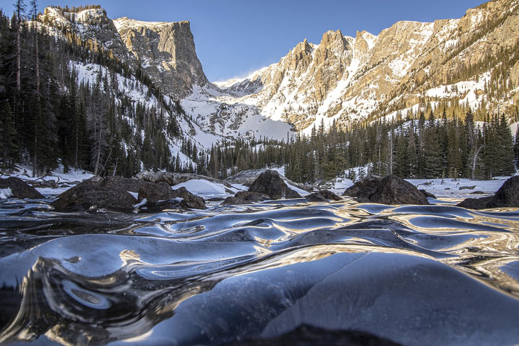 Frozen lake in the Rocky Mountains, by Eric Gross.