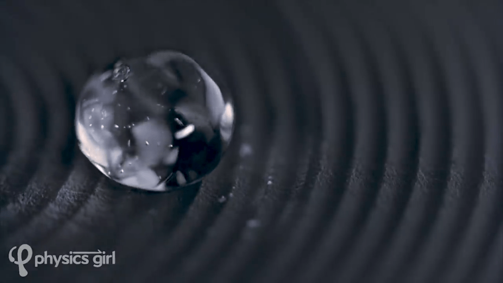 A Leidenfrost droplet hovering over a grooved surface bounces and ripples.