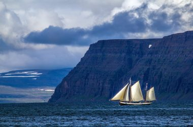 A sailboat in an Icelandic fjord.