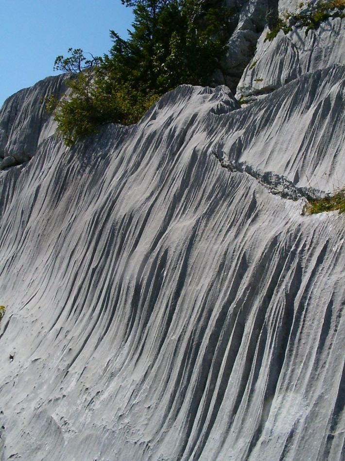 Long, parallel grooves called rillenkarren can form in limestone and gypsum.