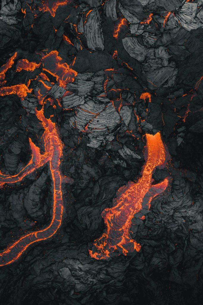 Orange lava stripes cross the black of cooling rock.