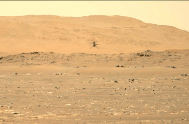 The Ingenuity helicopter in flight on Mars.
