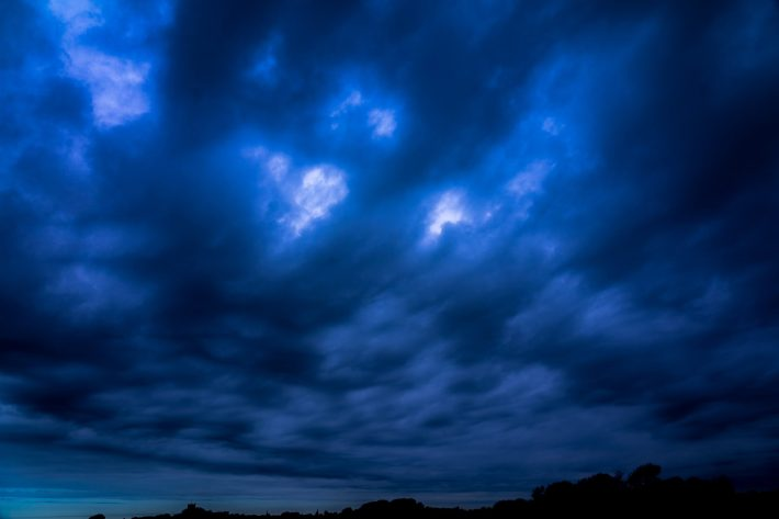 Noctilucent clouds shining at night.