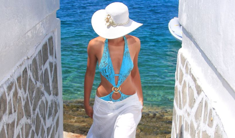 young-woman-in-bathing-suit-with-hat-in-the-greek-islands