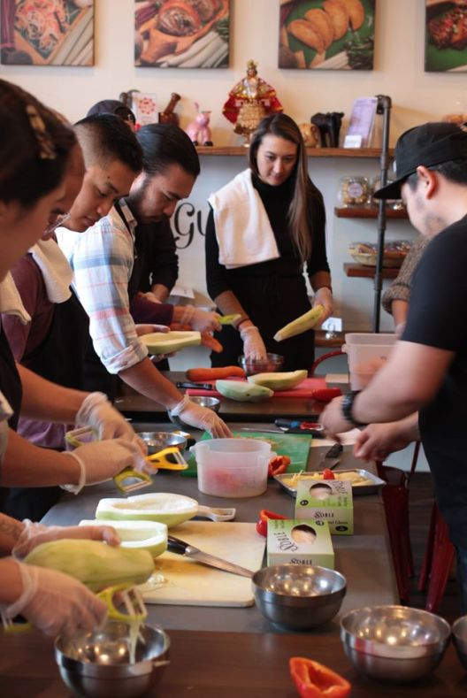 People chopping vegetables
