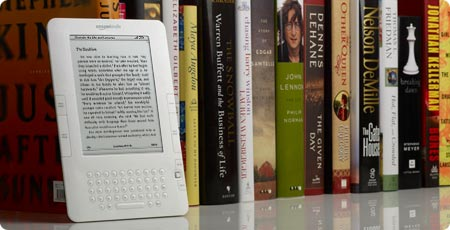 kindle in front of books