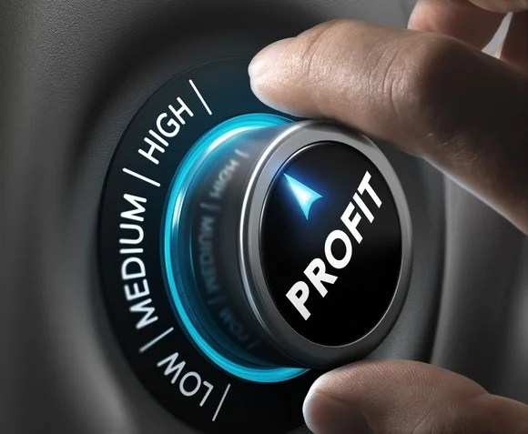 "Fingers turning a dial labeled ""profit"" to ""high"""