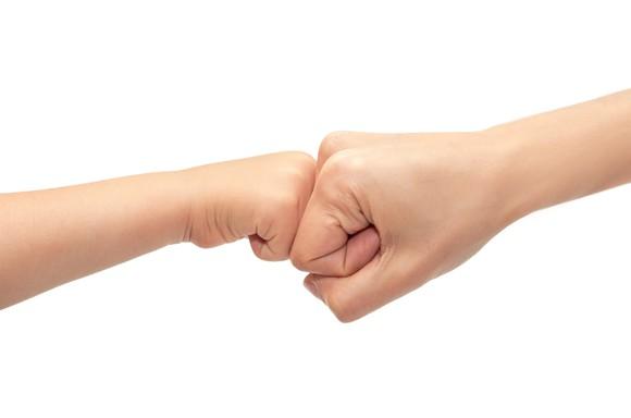 parent-child fist bump
