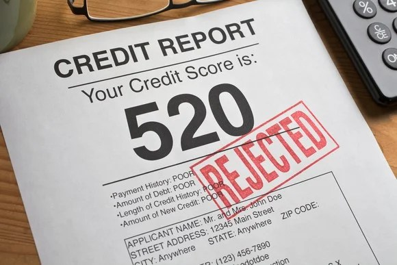 "Credit report with score of 520 and ""rejected"" stamped on the page."