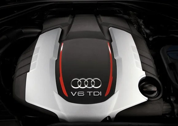 """The top of an engine, showing Audi's four-rings logo and """"V6 TDI""""."""