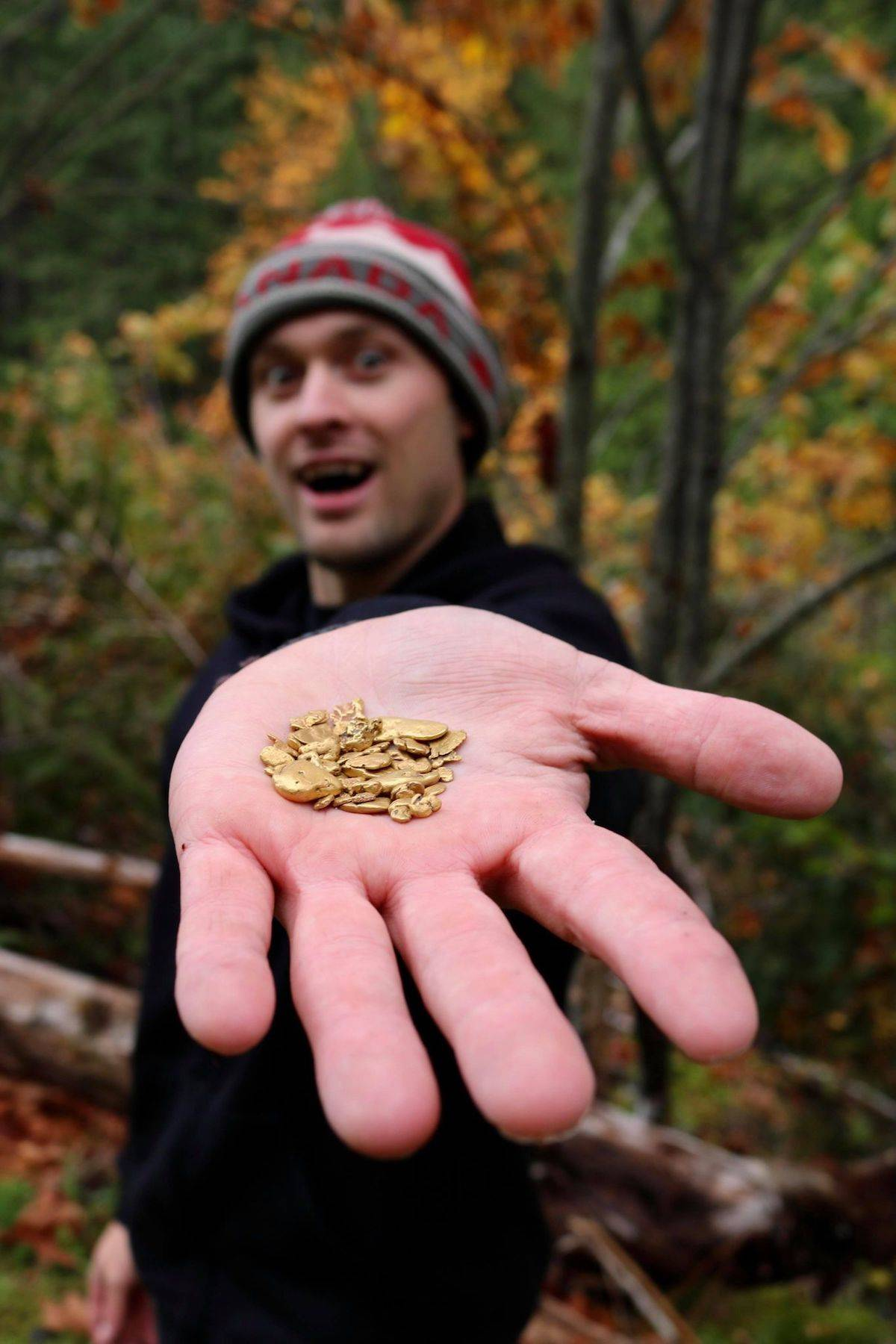 Paul Larouche shows off a handful of gold pieces he's found while gold panning, gold sniping and using a metal detector in Sooke. (Aaron Guillen/News Staff)