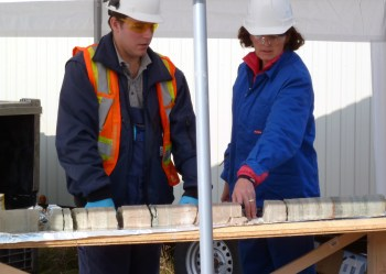 Beth Parker and Robert Stutzle examining bedrock core in the field