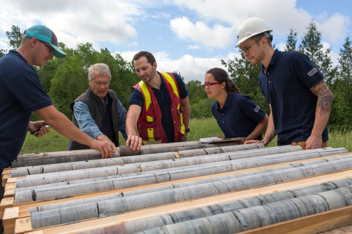 John Cherry and G360 researchers examining borehole core in the field