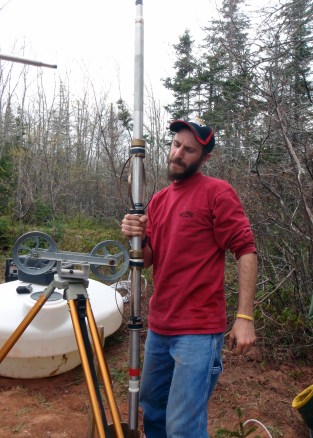 Technician handling a geophysical probe